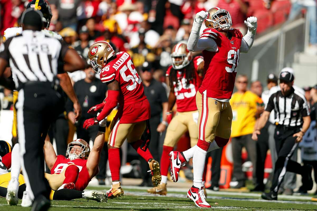 San Francisco 49ers' Arik Armstead (91) and Nick Bosa celebrate recovered fumble late in 4th quarter of 24-20 win over Pittsburgh Steelers in NFL game at Levi's Stadium in Santa Clara, Calif., on Sunday, September 22, 2019.