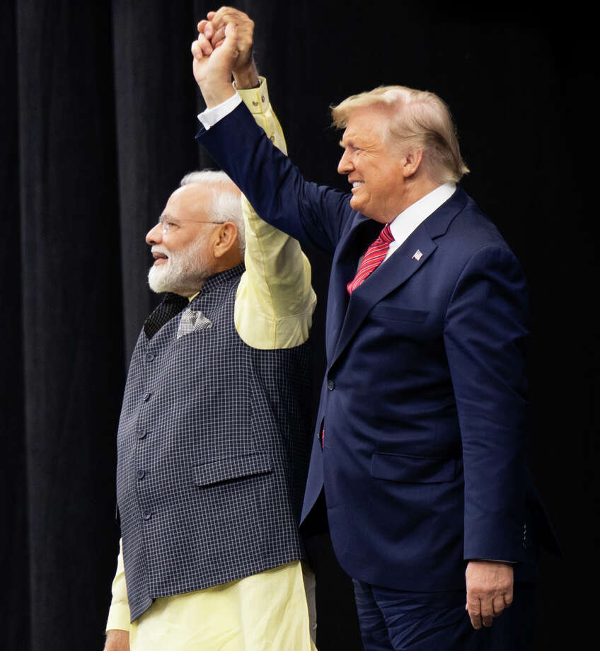 "US President Donald Trump and Indian Prime Minister Narendra Modi attend ""Howdy, Modi!"" at NRG Stadium in Houston, Texas, September 22, 2019. - Tens of thousands of Indian-Americans converged on Houston on Sunday for an unusual joint rally by Donald Trump and Narendra Modi, a visible symbol of the bond between the nationalist-minded leaders. With many in the crowd decked out in formal Indian attire or the signature saffron of Modi's Bharatiya Janata Party, the event kicked off in a football stadium with a Sikh blessing, boisterous bhangra dancing and, in a nod to local customs, cheerleaders in cowboy hats. (Photo by SAUL LOEB / AFP)SAUL LOEB/AFP/Getty Images Photo: SAUL LOEB / AFP or licensors"