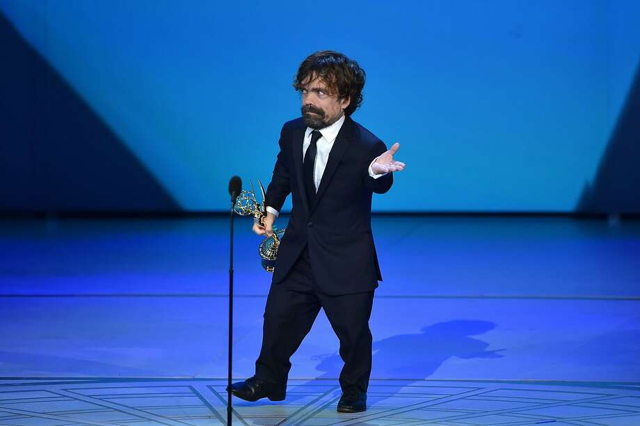 "(FILES) In this file photo taken on September 17, 2018 Peter Dinklage speaks onstage after winning an Emmy for Supporting actor in a drama series during the 70th Emmy Awards at the Microsoft Theatre in Los Angeles, California. - Television's glitzy big night out is upon us -- the 71st Emmy Awards kick off Sunday evening in Los Angeles. A little show called ""Game of Thrones"" looks set to dominate the proceedings one last time. But there is more to television's Oscars than the blood-spattered fight for the Iron Throne. For all its Emmy success, only one ""Thrones"" performer -- Peter Dinklage -- has ever won an acting statuette. This year, a whole host are in the race, including leads Emilia Clarke and Kit Harington. (Photo by Robyn BECK / AFP)ROBYN BECK/AFP/Getty Images Photo: Robyn Beck, AFP/Getty Images"