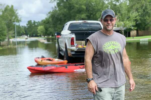 Kyle Daniels, the only person on Carroll Lane in Bevil Oaks to ride at the storm at home, has stayed busy kayaking around the neighborhood to provide damage assessments and feed his neighbors?• pets, including several cats, a dog and a guinea pig. He had stuck poles in some yards so people with security cameras could check the flood levels.