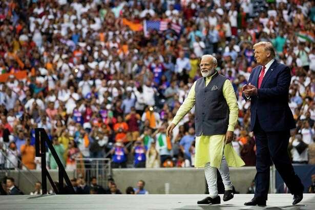 India Prime Minister Narendra Modi and United States President Donald Trump enter the NRG Stadium stage as part of the Texas India Forum on Sunday, Sept. 22, 2019, in Houston.