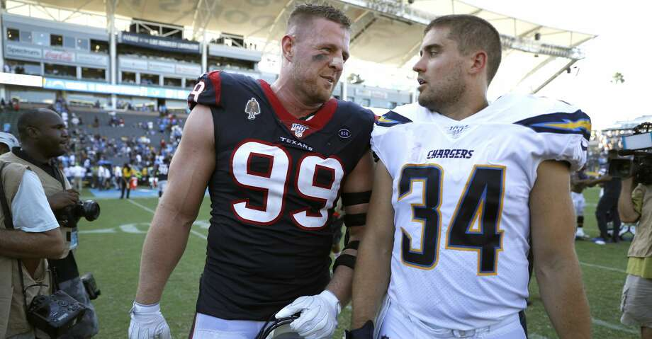 CARSON, CALIFORNIA - SEPTEMBER 22: Defensive end J.J. Watt #99 of the Houston Texans and brother fullback Derek Watt #34 of the Los Angeles Chargers talk after the game at Dignity Health Sports Park on September 22, 2019 in Carson, California. (Photo by Meg Oliphant/Getty Images) Photo: Meg Oliphant/Getty Images