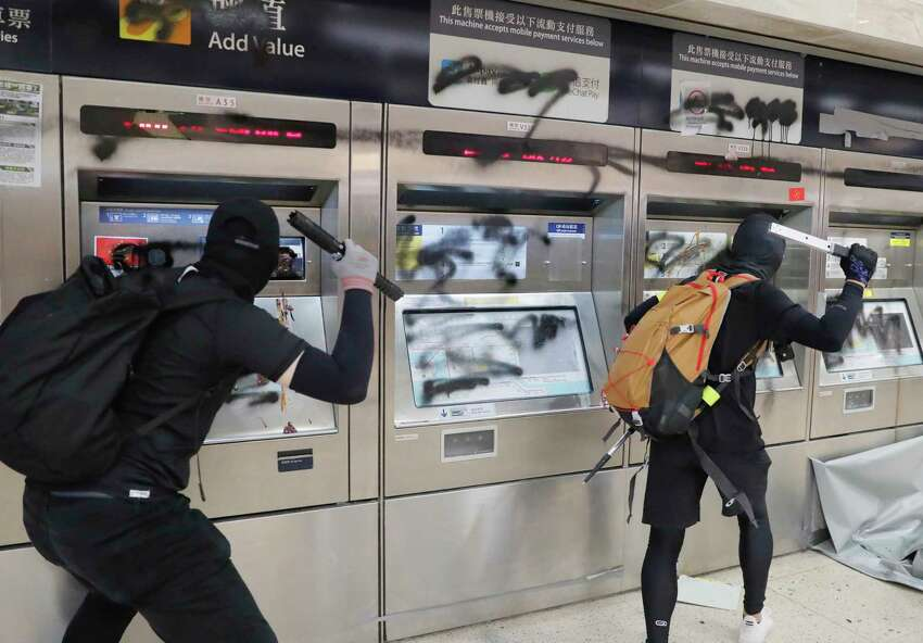 Protesters vandalize a subway station Sunday, Sept. 22, 2019, in Hong Kong. Protesters smashed surveillance cameras and electronic ticket sensors in the subway station, as pro-democracy demonstrations took a violent turn once again. (AP Photo/Kin Cheung)
