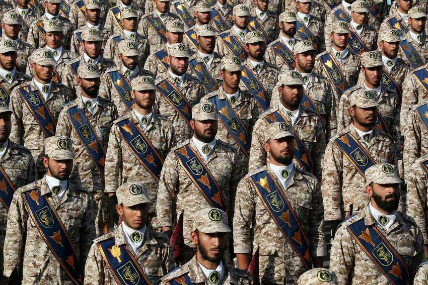 In this photo released by the official website of the office of the Iranian Presidency, Revolutionary Guard troops attend a military parade marking 39th anniversary of outset of Iran-Iraq war, in front of the shrine of the late revolutionary founder Ayatollah Khomeini, just outside Tehran, Iran, Sunday, Sept. 22, 2019. (Iranian Presidency Office via AP)
