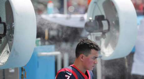 Houston Texans kicker Ka'imi Fairbairn sits under a misting fan before an NFL football game against the Los Angeles Chargers at Dignity Health Sports Park on Sunday, Sept. 22, 2019, in Carson, Calif.