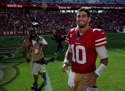 49ers' Jimmy Garoppolo leaves the field smiling again