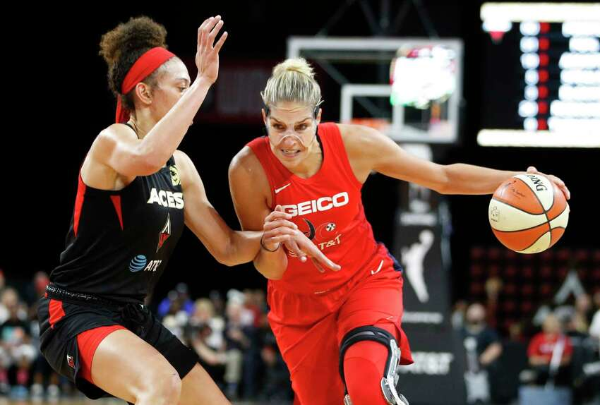 Washington Mystics' Elena Delle Donne drives around Las Vegas Aces' Dearica Hamby during the second half in Game 3 in the semifinals of the WNBA playoffs, Sunday, Sept. 22, 2019, in Las Vegas. (AP Photo/John Locher)