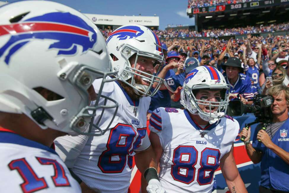 CORRECTS DATE - Buffalo Bills' Dawson Knox (88) celebrates with teammates Lee Smith (85) and Josh Allen (17) after scoring a touchdown during the first half of an NFL football game against the Cincinnati Bengals, Sunday, Sept. 22, 2019, in Orchard Park, N.Y. (AP Photo/John Munson)
