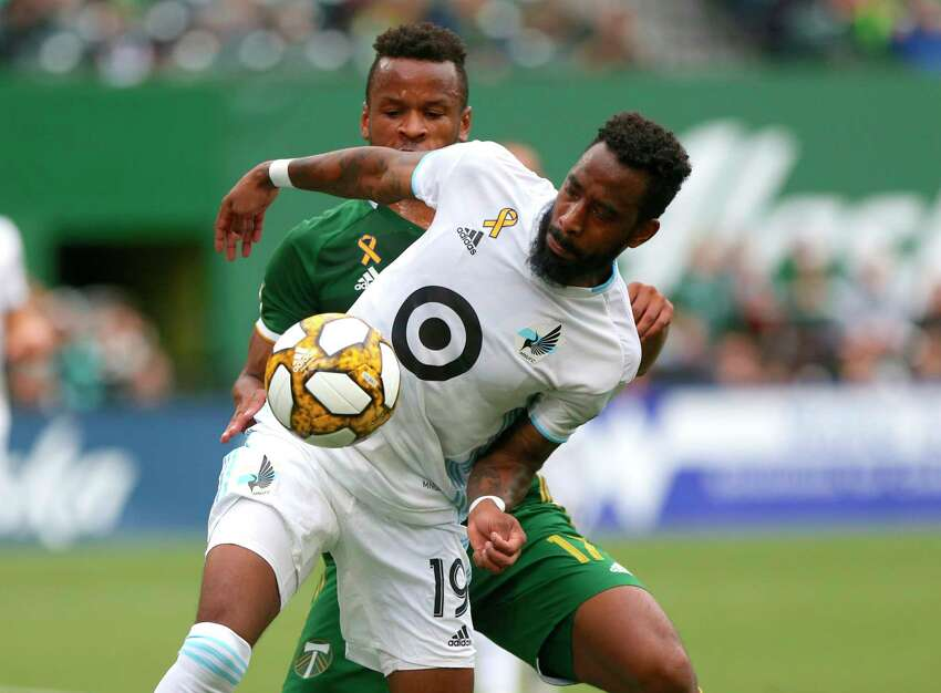 Minnesota United FC' Romain Metanire (19) shields the ball from Portland Timbers' Jeremy Ebobisse during an MLS soccer match at Providence Park, Sunday, Sept. 22, 2019, in Portland, Ore. (Sean Meagher/The Oregonian via AP)
