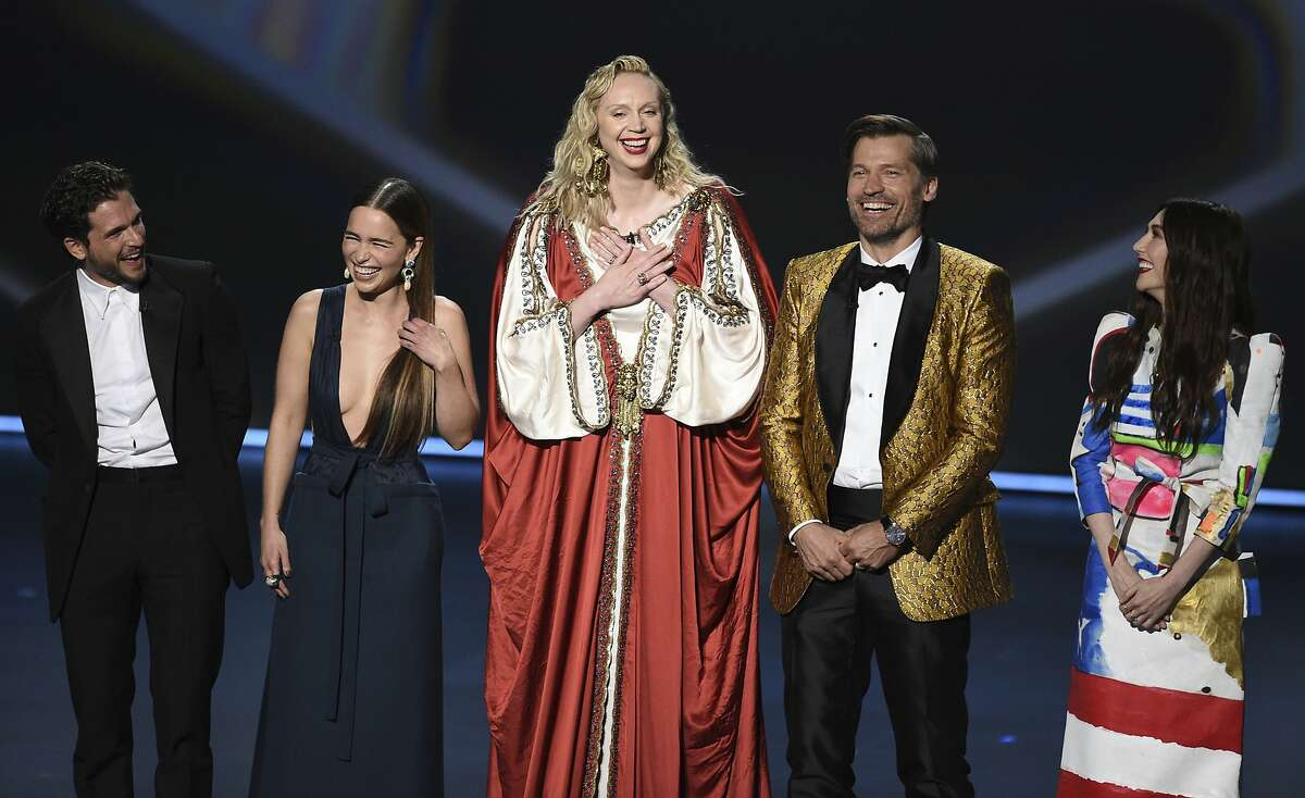 """Kit Harington, from left, Emilia Clarke, Gwendoline Christie, Nikolaj Coster-Waldau and Carice van Houten, of the cast of """"Game of Thrones,"""" appear on stage to present the award for outstanding supporting actress in a limited series or movie at the 71st Primetime Emmy Awards on Sunday, Sept. 22, 2019, at the Microsoft Theater in Los Angeles. (Photo by Chris Pizzello/Invision/AP)"""
