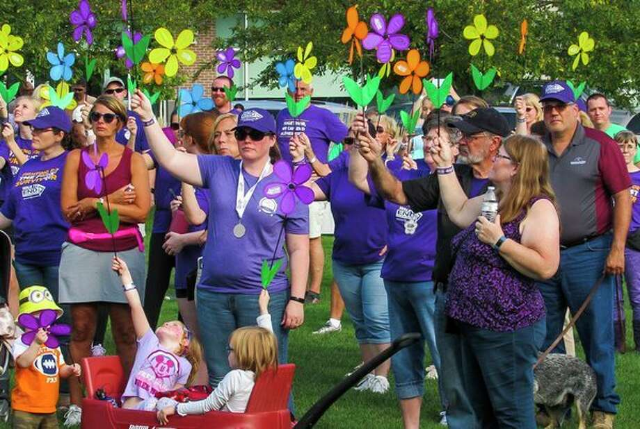More than 300 people from across Midland County gather Saturday at Dow Diamond to begin a 2.1-mile walk to raise money and awareness for the fight against Alzheimer's disease. As of this weekend, the local chapter of Alzheimer's Association has raised nearly $61,000 toward its year-end goal of $75,000 for the cause of curing Alzheimer's. For more photos, go to www.ourmidland.com. (Mitchell Kukulka/Mitchell.Kukulka@mdn.net)