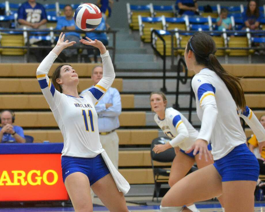 Wayland Baptist's Renzelle Horner sets the ball up during a SAC volleyball match against John Brown on Saturday in the Hutcherson Center. Photo: Nathan Giese/Planview Herald