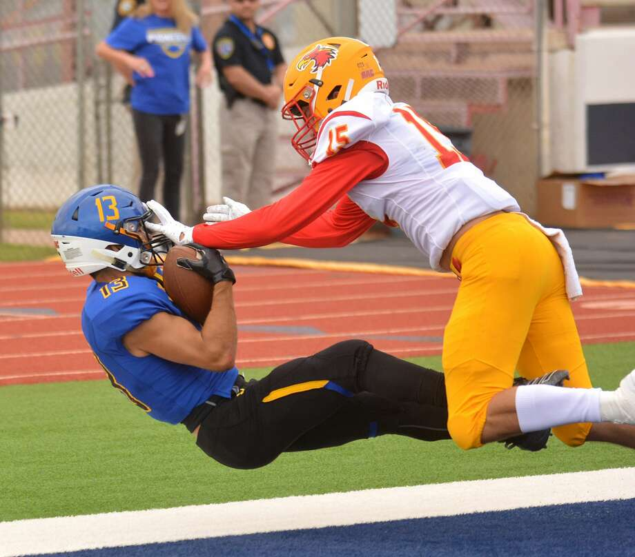 Wayland Baptist receiver Skyler Whitten hauls in a 29-yard touchdown pass from Mitchell Parsley behind Arizona Christian defender Riley Tucker during their Sooner Athletic Conference football game on Saturday at Greg Sherwood Memorial Bulldog Stadium. Photo: Nathan Giese/Planview Herald