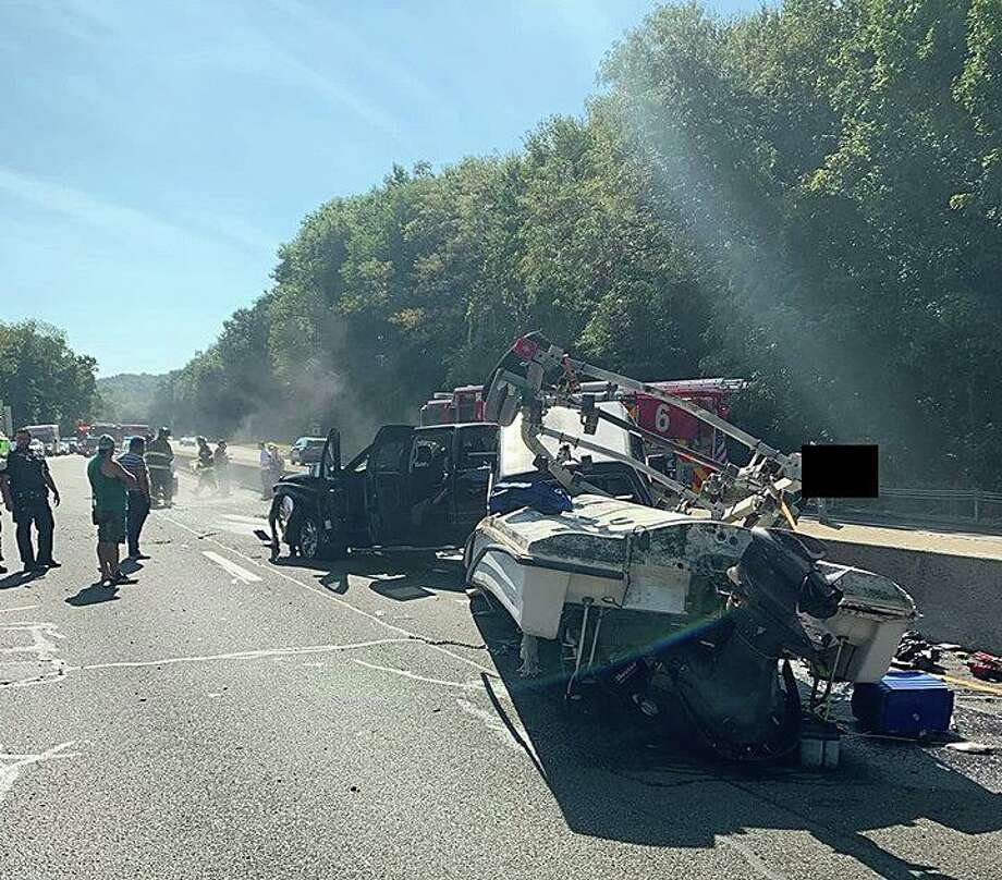 An accident involving a boat trailer - and some fish - caused heavy traffic delays on Route 8 Sunday afternoon. The Ansonia Fire Department and Ansonia Rescue and Medical Services said the crash happened around 2:30 p.m. just before northbound Exit 19. Photo: Ansonia Rescue And Medical Services Photo