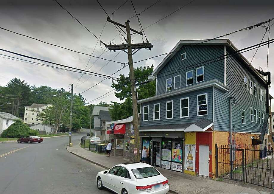 Waterbury police are looking for the man who shot a dog during an argument Wednesday. The dog was found injured behind a nearby building after police responded to a report of an argument outside the One Stop Grocers on Walnut Street, reports said. Photo: Google Street View Image