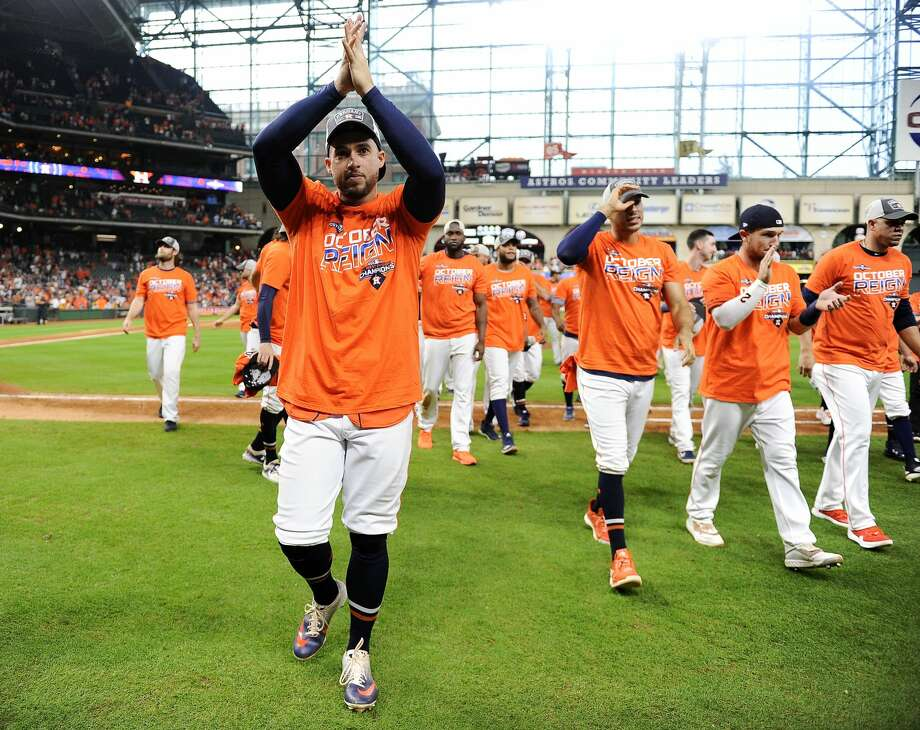 PHOTOS: The Astros' celebrate clinching another AL West title Houston Astros' George Springer, left, celebrates the team's clinching of the AL West crown after a baseball game against the Los Angeles Angels, Sunday, Sept. 22, 2019, in Houston. (AP Photo/Eric Christian Smith) Photo: Eric Christian Smith/Associated Press