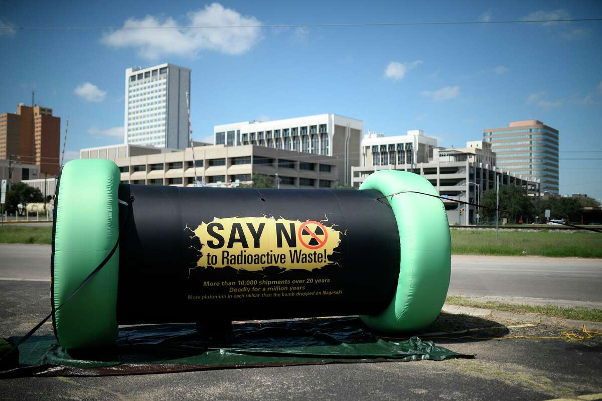 An inflatable life-size model of casks used to transport nuclear waste material is displayed near the intersection of Main Street and Industrial Sept. 29, 2018.