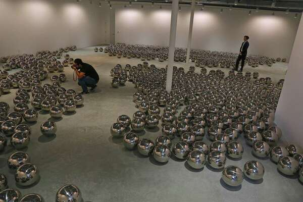 """""""Narcissus Garden"""" by Yayoi Kusama on display at the opening of the MoCA Westport on Sunday, Sept. 22, 2019, in Westport, Conn."""
