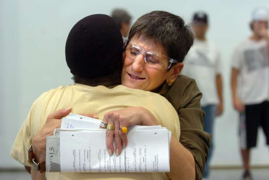 Congresswoman Rosa DeLauro hugs electrical installer Betty Lee, of Bridgeport, Thursday August 5, 2010 during a visit to the Sikorsky Aircraft Plant in Stratford. Photo: Autumn Driscoll / Connecticut Post