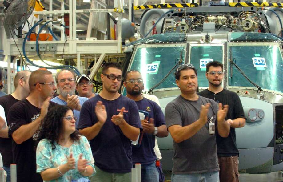Sikorsky Aircraft workers clap as Congresswoman Rosa DeLauro talks about sustaining American jobs Thursday August 5, 2010 during a visit to the plant in Stratford. Photo: Autumn Driscoll / Connecticut Post