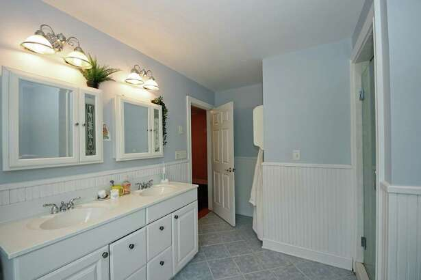 The bath shared by two of the second floor bedrooms has a double vanity.