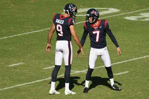 CARSON, CALIFORNIA - SEPTEMBER 22: Punter Bryan Anger #9 and kicker Ka'imi Fairbairn #7 of the Houston Texans celebrate making the extra point in the third quarter against the Los Angeles Chargers at Dignity Health Sports Park on September 22, 2019 in Carson, California.