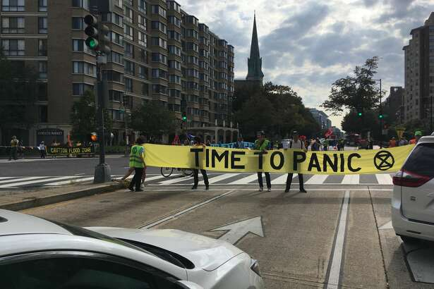 Climate activists shut down an intersection on Massachusetts Avenue in Washington, D.C., as part of a global push to shift the global economy away from fossil fuels.