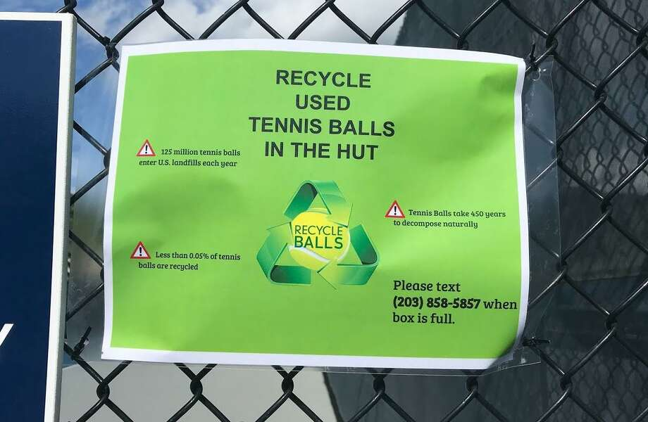 A sign informs tennis players they can recycle their old tennis balls at the Wilton courts on Route 7. Photo: Contributed Photo / Gerri Fox / Wilton Bulletin