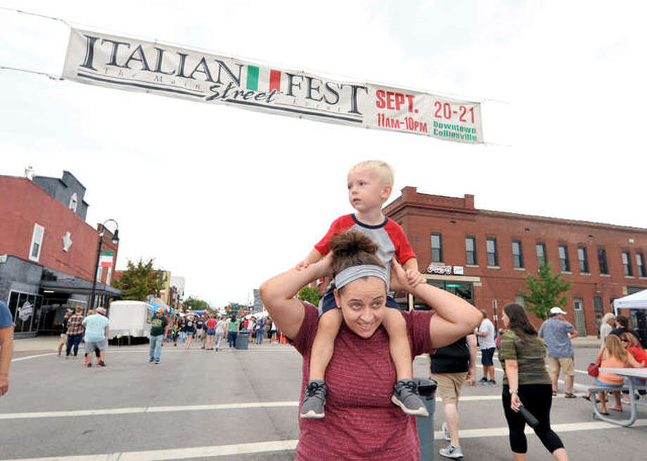 Kayla Harlin of Maryville carries her son Grayson, 2, on her shoulders as they attend the Italian festival in Collinsville Saturday. Since 1984, Collinsville has been celebrating its Italian culture and heritage. Photo: Thomas Turney | For The Intelligencer