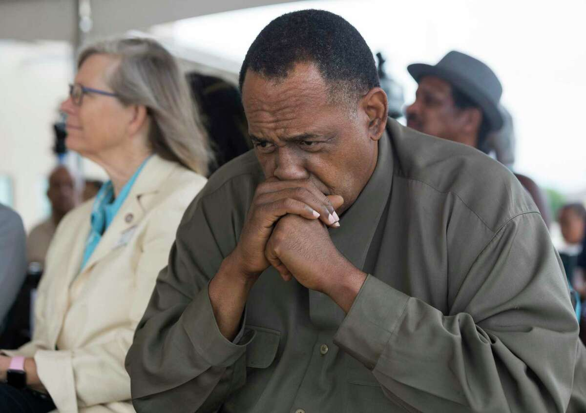 Activist Reginald Moore, right, listens to State Rep. Ron Reynolds, D-Missouri City, at a news conference celebrating progress on the Sugar Land 95 Memorial Project in Sugar Land in June.