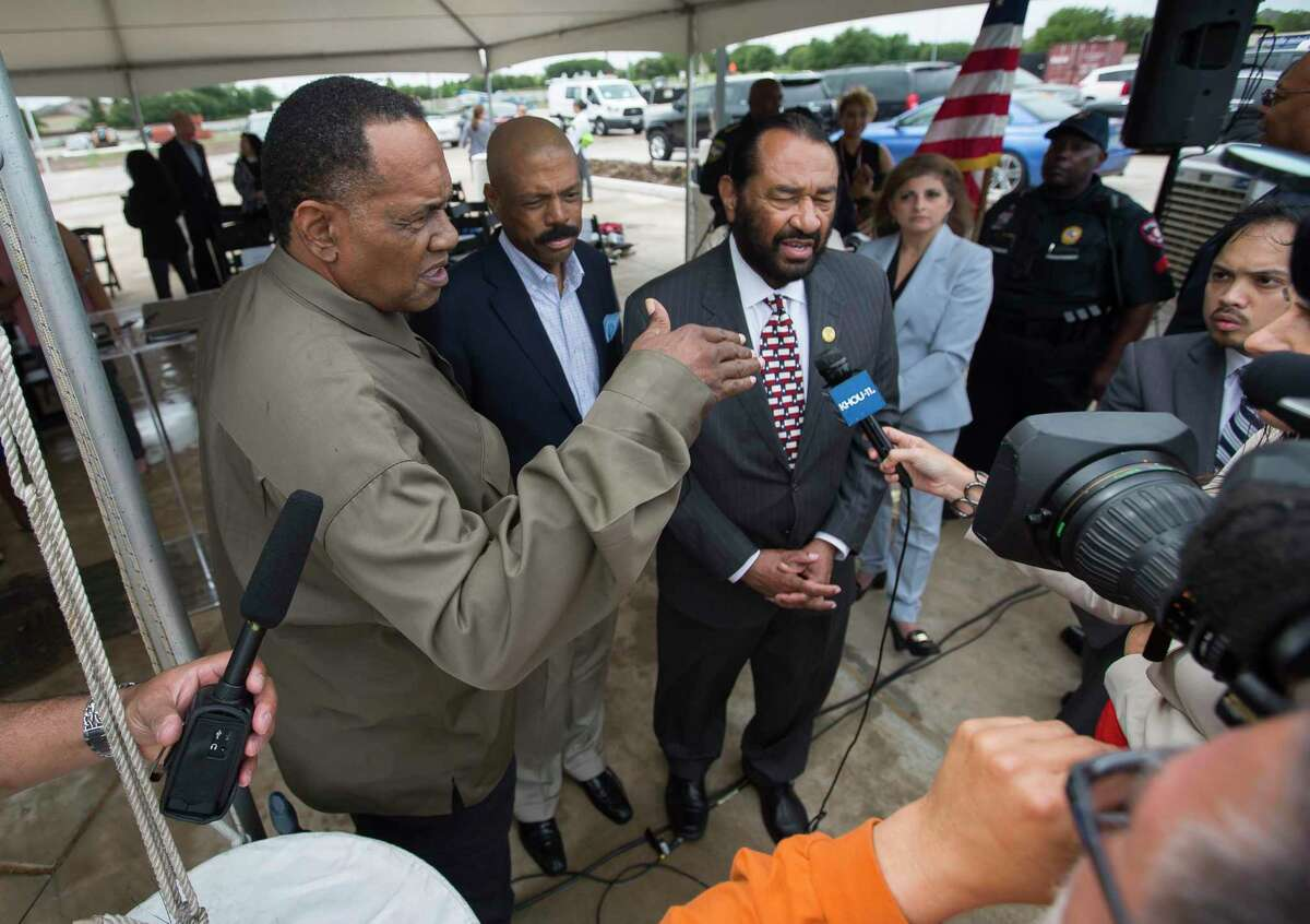 Activist Reginald Moore, from left, State Sen. Borris Miles, D-Houston, and U.S. Rep. Al Green, D-Houston, speak to the media following a news conference celebrating progress on the Sugar Land 95 Memorial Project in Sugar Land in June.