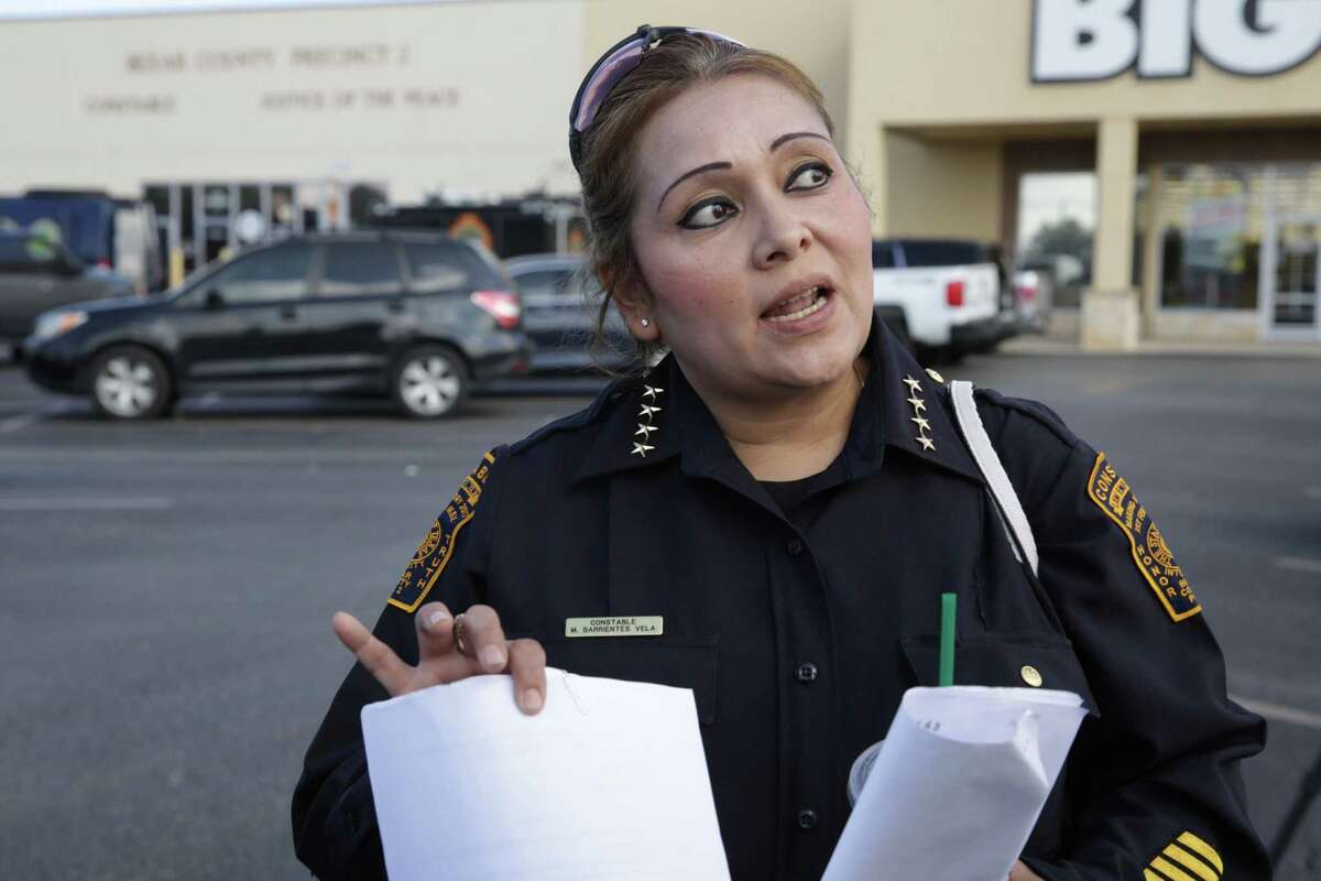 Precinct 2 Constable Michelle Barrientes Vela speaks to members of the media as FBI and Texas Rangers raid her office Monday, Sept. 23. ,