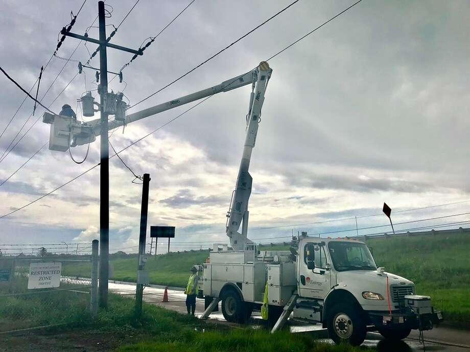 Entergy crews restore power after Tropical Storm Imelda. Photo provided by Entergy Texas Photo: Entergy Texas