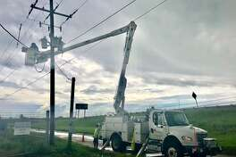 Entergy crews restore power after Tropical Storm Imelda. Photo provided by Entergy Texas