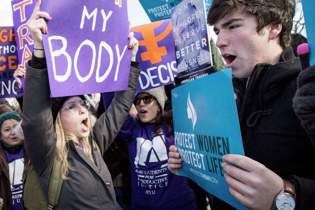 WASHINGTON, DC - MARCH 2: Pro-choice advocates (left) and anti-abortion advocates (right) rally outside of the Supreme Court, March 2, 2016 in Washington, DC. On Wednesday morning, the Supreme Court will hear oral arguments in the Whole Woman's Health v. Hellerstedt case, where the justices will consider a Texas law requiring that clinic doctors have admitting privileges at local hospitals and that clinics upgrade their facilities to standards similar to hospitals. (Drew Angerer/Getty Images)
