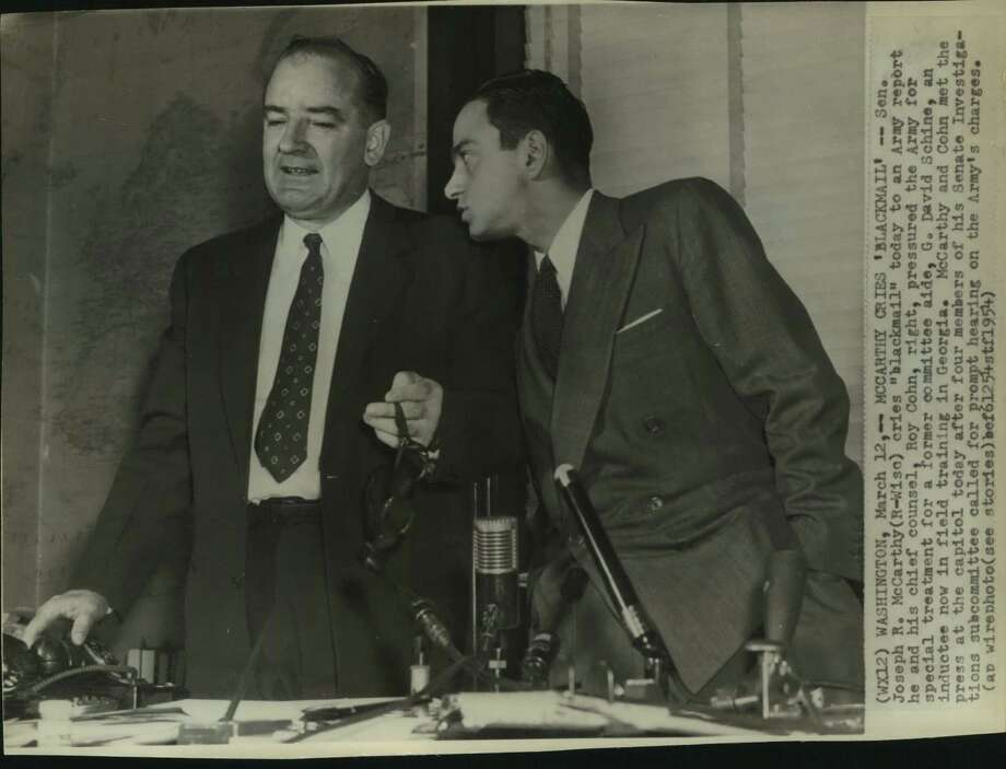 "Sen. Joseph McCarthy, Republican of Wisconsin, cries ""Blackmail"" in 1954 after an Army report said he and his chief counsel, Roy Cohn, right, pressured the Army for special treatment for a former aide, G. David Schine. Photo: Associated Press / San Antonio Express-News"