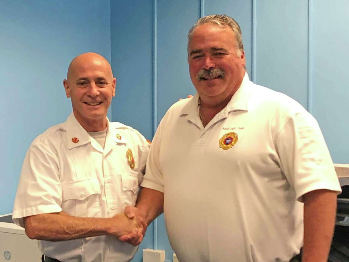 Assistant Fire Chief Gary Baker, right, is with Fire Chief Doug Edo as Baker retired recently from the Milford Fire Department.