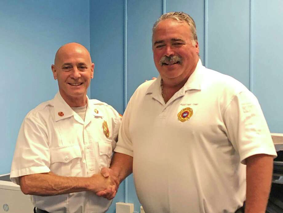 Assistant Fire Chief Gary Baker, right, is with Fire Chief Doug Edo as Baker retired recently from the Milford Fire Department. Photo: Milford Fire Department / Contributed Photo