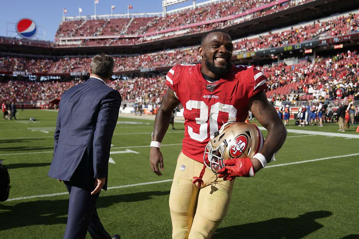 San Francisco 49ers running back Jeff Wilson Jr., right, celebrates with general manager John Lynch after an NFL football game against the Pittsburgh Steelers in Santa Clara, Calif., Sunday, Sept. 22, 2019. (AP Photo/Tony Avelar)
