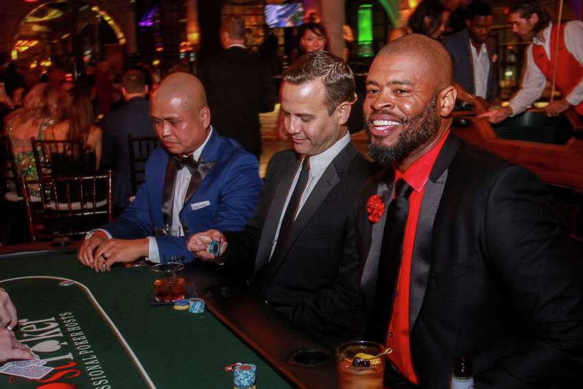 Chris Tangalin, from left, Brandon Childs and Wade Smith at Smith's Celebrity Poker Tournament and Casino Night, Bulls and Blackjack, at the Astorian on September 20, 2019.