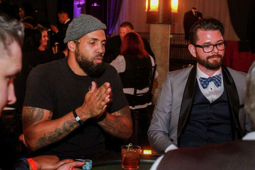 Arian Foster, left, and Erick Warax at Wade Smith's Celebrity Poker Tournament and Casino Night, Bulls and Blackjack, at the Astorian on September 20, 2019.