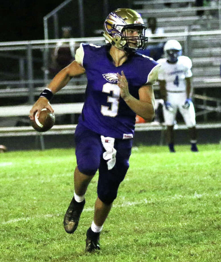CM quarterback Noah Turbyfill rolls out looking for a receiver in a Sept. 13 game against Cahokia in Bethalto. The Eagles rebounded from that loss to the Comanches to beat rival Jersey on Friday in Jerseyville. Photo: Greg Shashack / The Telegraph