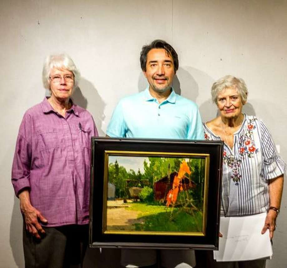 "KAA co-presidents Patsy Stroble, left, and Connie Horton, right, present the Founders Award/Best-in-Show to Zufar Bikbov, of Oakville, for his oil painting ""Take Me To The Lake."" Photo: KAA / Contributed Photo"