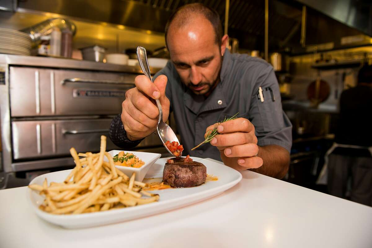 Stéphane Meloni prepares food from his native Provence at Castagna in San Francisco's Marina district.
