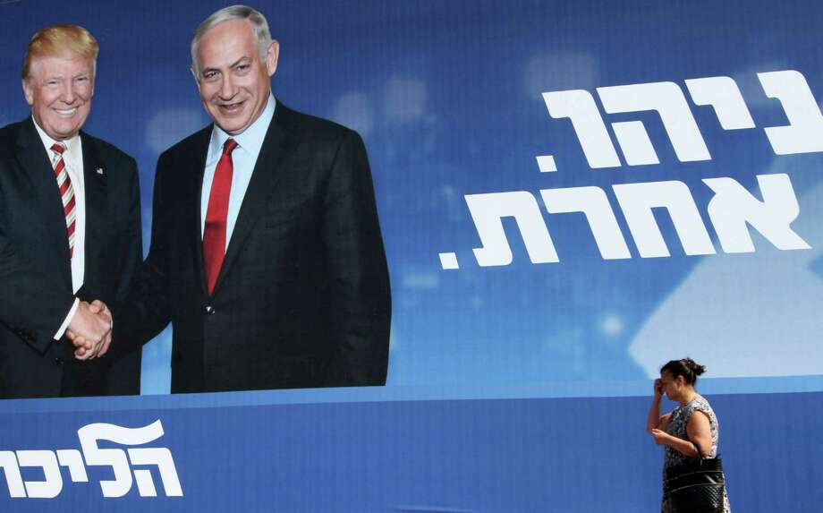 "An Israeli election billboard for the Likud party shows Donald Trump shaking hands with Prime Minister Benjamin Netanyahu with a caption in Hebrew reading ""Netanyahu, in another league."" Israeli voters have turned away from the Likud as the country's ruling party. Photo: Gil Cohen-Magen /Getty Images / AFP or licensors"