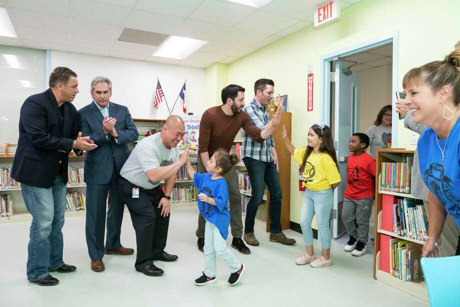 "Drew and Jonathan Scott of HGTV's ""Property Brothers"" unveil a newly renovated library for elementary students at Burnett Elementary School in Pasadena. Burnett was chosen out of thousands of nominations to receive a library makeover through the Scott brothers and the group Heart of America. Photo: Anthony Rathbun, FRE / Associated Press / Copyright 2019 The Associated Press. All rights reserved"