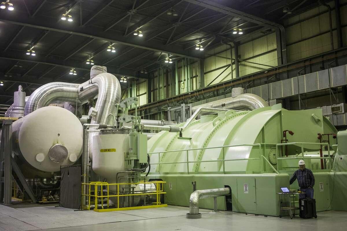 Steam turbines are located inside the turbine building at Midland Cogeneration Venture in Midland. (Katy Kildee/kkildee@mdn.net)