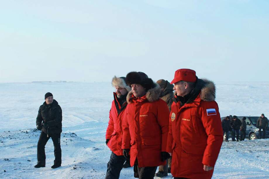 From right: Vladimir Putin, Russia's president, Dmitry Medvedev, Russia's prime minister, and Sergei Donskoi, Russia's natural resources minister, visit an environmental clean up operation on Alexandra Land Island in the Franz Josef Land archipelago, Russia, on March 29, 2017. Photo: Bloomberg Photo By Anna Andrianova. / © 2017 Bloomberg Finance LP