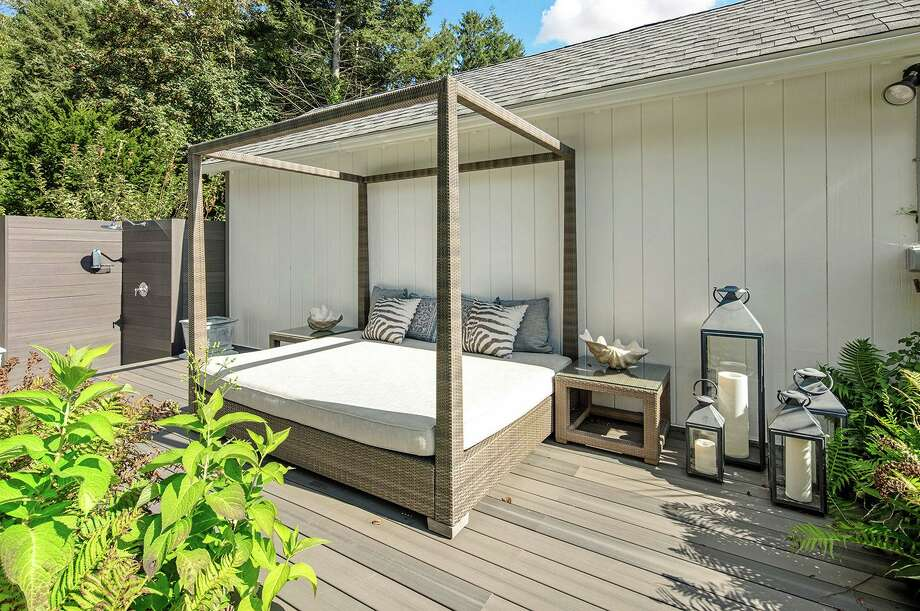 After a long day's work on the farm there is a chance to shower outside and then lounge on a deck behind one of several outbuildings.