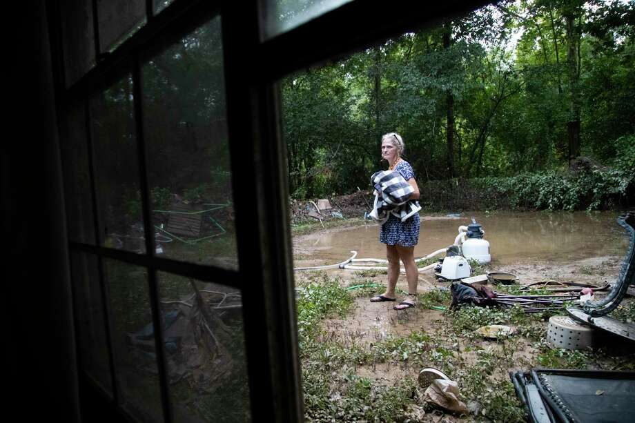 Tammie Hall, 54, looks around her backyard on Friday, Sept. 20, 2019 noticing that her pool is gone after Tropical depression Imelda wiped away her belongings. Her home is located in New Caney. Photo: Marie D. De Jesús, Houston Chronicle / Staff Photographer / © 2019 Houston Chronicle